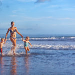 Mom with two kids on the beach